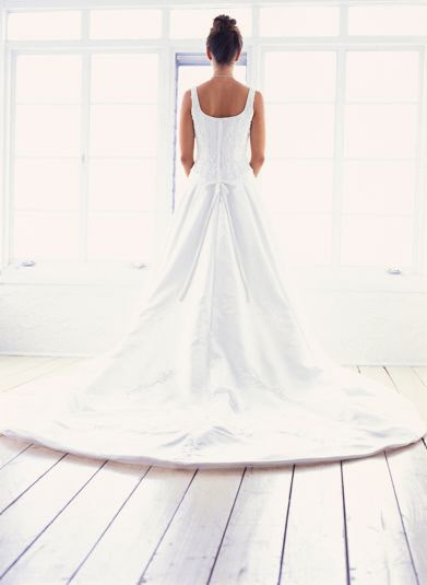 back view of woman in wedding gown